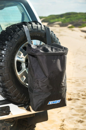 Use a spare wheel bag for bin to keep ants out of caravan