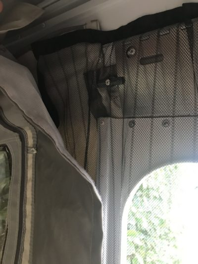 Tuck the sides at the top of magnetic fly screen between canvas in Jayco Swan