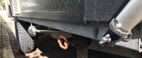 Front Support Pole Attached to Front of Jayco Swan Chassis with Wing Nut