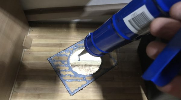 Applying Layer of Fire Resistant Sika Silicone Sealant for Diesel Heater Base Plate