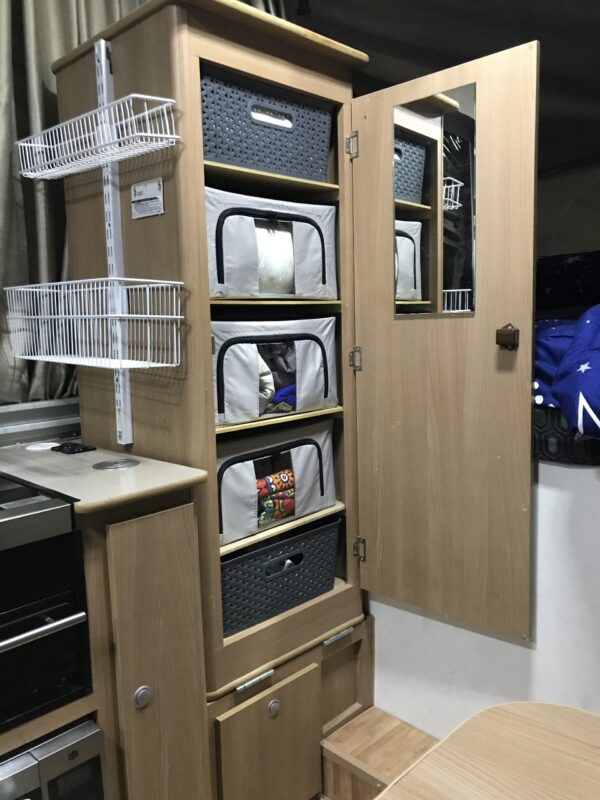 MDF wardrobe shelves in Jayco Swan Camper Trailer with Aldi Collapsible Storage Boxes