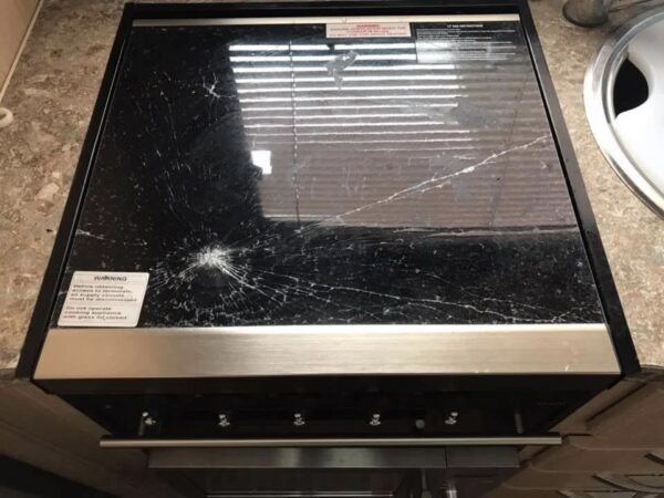 Smashed Jayco camper trailer stove top glass
